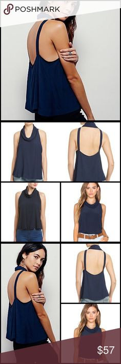 Free People City Lights Navy Cowl Top City Lights dark navy sleeveless cowl top. The Free People City Lights sleeveless, semi sheer cowl neck top in a slinky fit. Dropped armholes and strappy open back. :: 84% rayon, 16% viscose Free People Tops Tank Tops