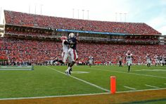 Georgia Bulldogs cornerback Damian Swann (5) breaks up a pass intended for Auburn Tigers wide receiver Sammie Coates (18) in the first of th...