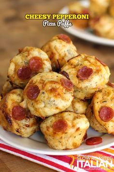Bite Size Cheesy Pepperoni Pizza Puffs...serve with your favorite marinara sauce.  These are the perfect party appetizers!  Make these in 30 minutes and watch them disappear!