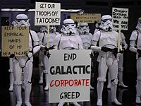 """""""It wasn't glamorous but I had a steady living working on my uncle's moisture farm,"""" says a protest sign held by Luke Skywalker. """"My aunt and uncle were unjustly murdered and the farm destroyed. I was forced to leave my home and join an extinct cult just to survive. I am now a member of an upstart movement to take down a greedy corrupt establishment. I AM THE 99%."""""""