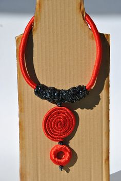 shiny red satin necklace pendant spiral VHS tape facets pearls button loop fastening €32,00