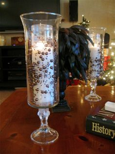 Williams Sonoma knock off from $1 Store: tall simple vase adhered with Gorilla Glue to a candle holder add a 'feast' white candle and a bit of beaded garland (from Michaels) and you've upscaled a beautiful hurricane candle!
