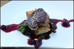 Pan seared foie gras with apple bread pudding, maitaike mushrooms and blue berry compote.