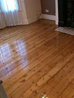 Original 1930 house with pine floor boards after sanding, staining with med oak colour and finishing with 3 coats of clear lacquer