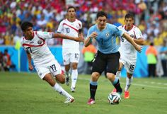 Cristian Rodriguez of Uruguay controls the ball against Yeltsin Tejeda of Costa Rica during the 2014 FIFA World Cup Brazil Group D match bet...