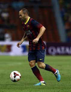 Andres Iniesta of Barcelona FC iruns with the ball during the friendly match between FC Barcelona and Malaysia at the Shah Alam Stadium on August 10, 2013 in Kuala Lumpur, Malaysia.