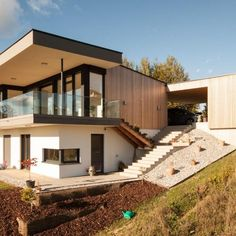 sandwich | holz.architekten Classic Architecture, Concept Architecture, Facade Architecture, Residential Architecture, Contemporary Architecture, Japanese Architecture, Sustainable Architecture, Houses On Slopes, Hillside House