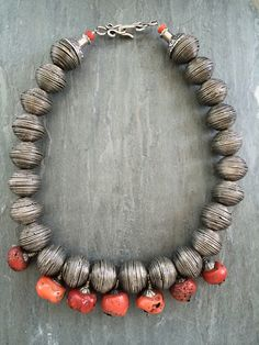 Silver beads with vintage natural coral