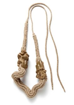 Ineke Heerkens. Necklace: Multi Digit Thick, 2013-14. Ceramic, linen. 310 x 160 x 55 mm; Length cord ± 190 cm. Collection: Shifting Mass  . Technique: hand shaped clay, spraying glaze, combination of machine and hand braided cord  . Photograph by Eddo Hartmann.