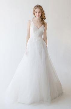 Bridal style Ula by Kelly Faetanini. Tulle ball gown with chantilly lace V-neck and low back. Natural waist with chantilly lace applique and lace cascades on back skirt. Bridal Gowns, Wedding Dresses by Kelly Faetanini