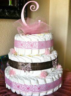Pink initial girl diaper cake