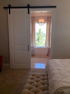 Barn door between master bedroom and bath.