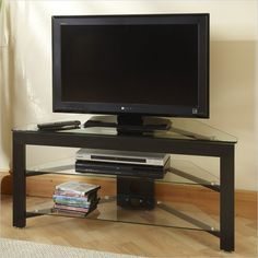 Convenience Concepts Wood and Glass TV Stand for Flat Panel TV is up to or Black Corner Tv Stand, Tv Stand Price, Corner Tv Cabinets, Flat Screen Tv Stand, Tv Stand Cabinet, Glass Tv Stand, Tv Entertainment Centers, Hidden Tv, Flat Panel Tv