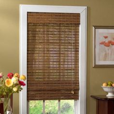 I have a HUGE roll of this bamboo shade material and I've been thinking of how to use it as valances above the windows.