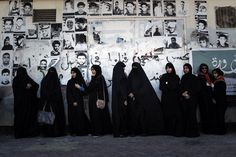 Bahraini Shiite Muslim women, some of whom are wearing the niqab, stand watching an anti-government rally to demand reforms in the village of Malikiya, South of Manama, on February 3, 2013, . The Gulf state has been shaken by unrest since its forces in March 2011 crushed a month of popular Shiite-led protests demanding greater rights and an end to what they said was discrimination by the Sunni royals. AFP PHOTO/MOHAMMED AL-SHAIKH