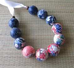 Necklace - Washi Paper Covered Wood Beads - Multi-color. $35.00, via Etsy.  either fabric or paper.