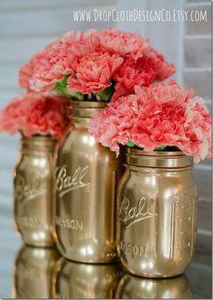 Gold Mason Jars.. White hydrangeas or peonies would be perfect on the night stands!