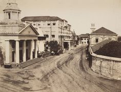 Scotch Church, Court-House, and entrance to the Dock-Yard, Bombay. The Bombay's first ice house(ice storage house where ice unloaded from ship was stored) next to the harbour ;seen in the photo as a rounded white dome house;next to the church--1850/60s by Charles Scott.
