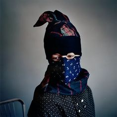 """Trine Søndergaard's photo series, """"Strude,"""" The headgear worn is called a strude worn in Fano Denmark and some centuries ago, in the pre-Goretex era, its function was to protect the faces of Danish women against the brutal elements of Northern Europe. Trine traveled back to Fanø and photographed a bunch of ladies wearing their ancestors threads. #Fanø"""