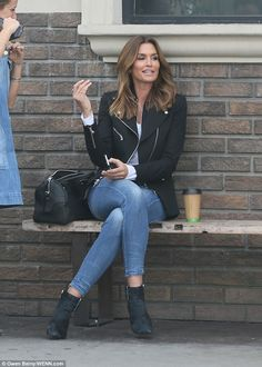 Fabulous at 50! Cindy Crawford showed no signs of slowing down as she headed to work filmi...
