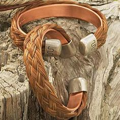 HORSE HAIR BRACELET  This unique cuff bracelet is crafted of genuine, braided horse hair backed by a solid copper band. The horsehair braids are accented with handmade sterling silver end caps sport the renowned King Ranch Running W brand. Colors will vary. Horse Hair Bracelet, Horse Hair Jewelry, Equestrian Jewelry, Equestrian Style, Leather Belts, Leather Jewelry, Beach Rock Art, Leather Working Patterns, King Ranch