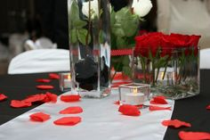 To add red to the theme we sprinkled rose petals around the table arrangements.
