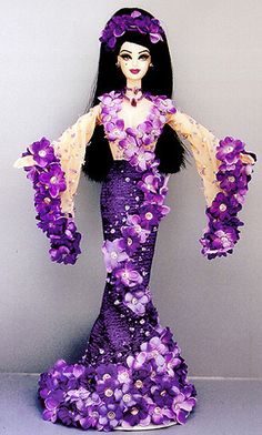 Miss Guam 2000   ninimomo dolls - A good way to design the flowers by swooping up to around the neck. Not sure about the sleeves.