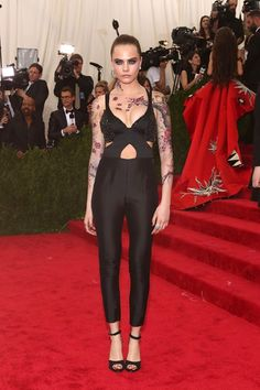Cara Delevingne chose a Stella McCartney jumpsuit for the red carpet. Met ball 2015