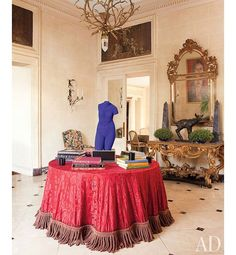 A Blue Venus sculpture by Yves Klein accents the entrance hall; the lantern hanging above is by Hervé Van der Straeten from Ralph Pucci International.