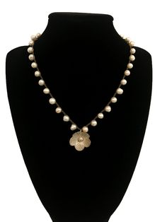 Natural Pearl Hemp Necklace with Silver Flower Charm https://www.etsy.com/listing/629736277/natural-pearl-hemp-necklace-with-silver?utm_source=crowdfire&utm_medium=api&utm_campaign=api