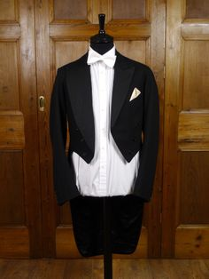 1930s 1940s Vintage Savile Row Bespoke Black Evening Tailcoat made for Army Captain 34L. Note that the left lapel is cut higher in order to allow display of regimental insignia / medals.