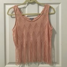 ✨Peach Crochet & Fringe Top✨ Crochet too with fringes. Perfect for festivals or summer concerts! Size medium. Great condition. No trades. Priced higher because of the detail with crochet and fringe.                        ✨Fast Shipper! 0.9 days on average.                   ✨Average rating of 5.0.                                         ✨Top 10% seller Charlotte Russe Tops