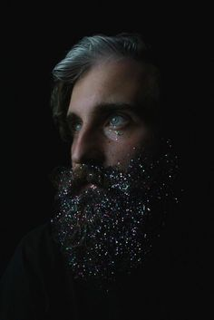 """The Galaxy Beard - """"Redditor 'delpaint' often does arty things with his glorious beard. This one is called the Galaxy Beard, and it came with a long-term contract of sorts. The post was titled 'No amount of hot showers will get rid of the glitter on me now.' The picture is awesome, but remember that glitter lasts forever. He may be finding glitter on his collars for years, if he ever gets enough of it out of the beard to look normal again."""""""