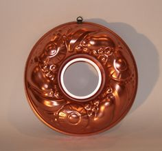 "Vintage Copper Tone Round Mould/Jello Mold. Copper toned inside. Featuring pineapple slices, pears, and bananas make this an unusual mold. Measures 13"" diameter. In good clean condition with almost no"