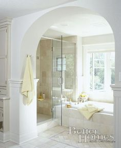 Light and airy bathroom with big standing shower (and again, windows over the tub... hahaha)