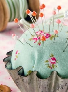 An easy peasy make – sew squares or spheres and stuff with wadding.    They look so pretty placed in vintage cake moulds or teacups.    You could add pretty vintage lace, buttons and fabric scraps to embellish.