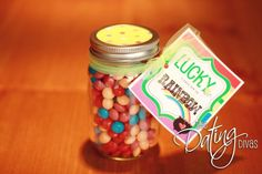 """Fill  the jar with candy that perfectly displays the rainbow – delicious Skittles!  Finally, attach the tag that reads, """"Lucky Me To Have You At The End Of The Rainbow!"""""""
