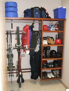 John Louis Home solid wood shelving closet design with bike and ski  storage. Organización Del e05aacb69055