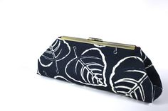 Hey, I found this really awesome Etsy listing at https://www.etsy.com/listing/179226117/frame-clutch-purse-navy-clutch