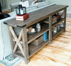 This is what I am envisioning for the wall table in the kitchen, only with a solid (not plank) top. And it needs to be colored the same as my cabinets but easy to work on... maybe it could be covered with a countertop material?? But I like the X at the end, and the shelves.