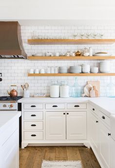 Open shelves, subway tiles, and a statement-making copper hood make Lauren Conrad's kitchen feel both clean and warm.