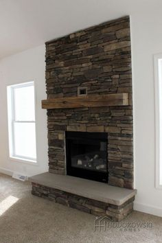 We just can't get enough of this custom cultured stone fireplace- Boral America . - We just can't get enough of this custom cultured stone fireplace- Boral America stone: Southern L - Reface Fireplace, Wooden Fireplace, Brick Fireplace Makeover, Home Fireplace, Fireplace Remodel, Fireplace Design, Fireplace Mantels, Fireplace Stone, Fireplace Ideas