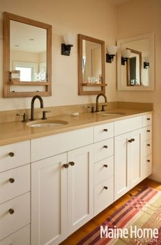 simple bathroom....love all the under-cabinet storage....more drawers....counter height to floor.