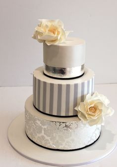 Fondant Covered Cake with Damask Royal Icing, Gumpaste Flowers and Silver Leaf.