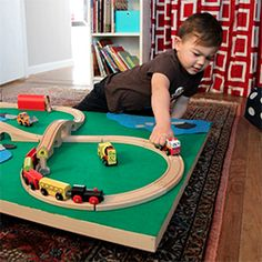 A DIY train table that slides under the bed for easy clean-up.