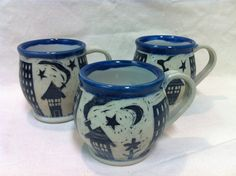 These mugs are very popular at my sales. The sgraffito is complimented with a simple band of colour around the rim. This particular design is city, blue.
