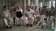 """One Flew Over the Cuckoo's Nest"" The group therapy circle with McMurphy in a dominant position in the middle."