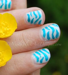 4 Of The Best Tutorials on How To Do Zebra Nail Art.