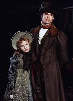 "Kirsten Dunst as Claudia and Brad Pitt as Louis de Pointe du Lac in ""Interview With the Vampire"" directed by Neal Jordan. Based on the best-selling novel by Anne Rice. Brad Pitt, Anne Rice, Movies Showing, Movies And Tv Shows, Lestat And Louis, Queen Of The Damned, The Vampire Chronicles, Interview With The Vampire, Looks Dark"