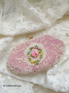 Small silk purse covered in vintage lace and embellished with French trim and silk ribbon flower